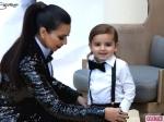 Kardashian-Christmas-Card-Kim-Mason-Chair-Smile-580x435