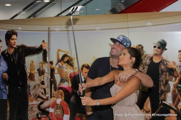 (DJ Drama and Jessica Burciaga taking an Usie with a Selfie Stick)