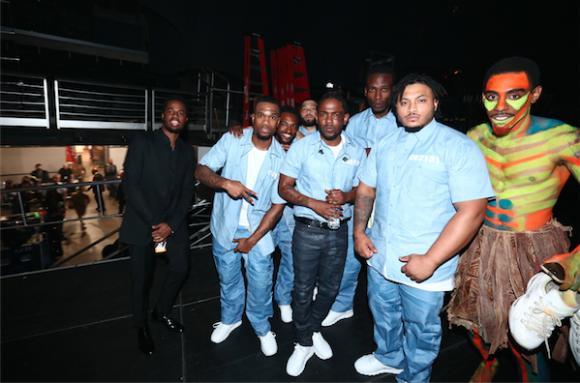 Kendrick Lamar backstage with his dancers.