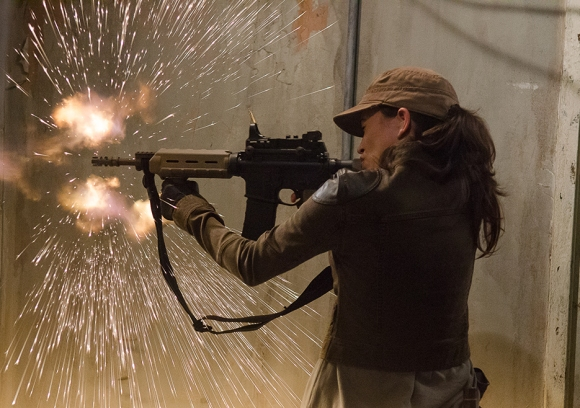 Rosita firiing off shots AMC/Gene Page