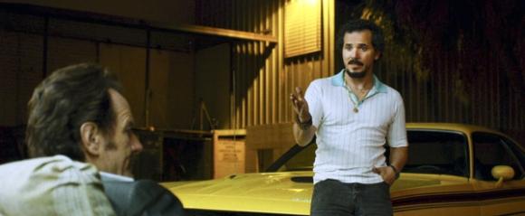 Bryan-Cranston-stars-as-undercover-Customs-agent-Robert-Mazur-and-John-Leguizamo-as-his-partner-Emir-Abreu