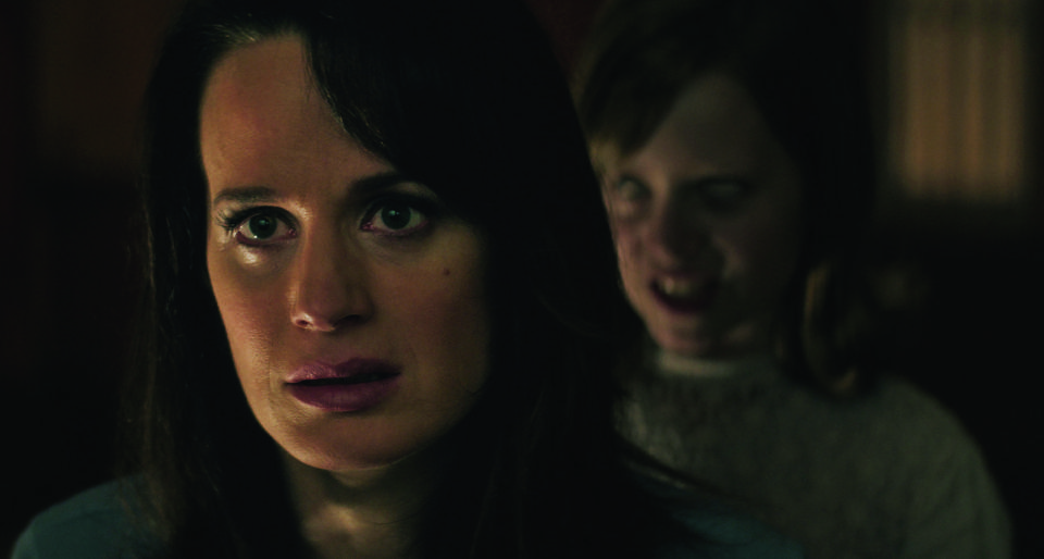 """(L to R) ALICE REASER is set upon by LULU WILSON as her daughter Doris in """"Ouija: Origin of Evil."""" Inviting audiences again into the lore of the spirit board, the supernatural thriller tells a terrifying new tale as the follow-up to 2014's sleeper hit that opened at No. 1. In 1965 Los Angeles, a widowed mother and her two daughters add a new stunt to bolster their séance scam business and unwittingly invite authentic evil into their home. When the youngest daughter is overtaken by the merciless spirit, this small family confronts unthinkable fears to save her and send her possessor back to the other side."""