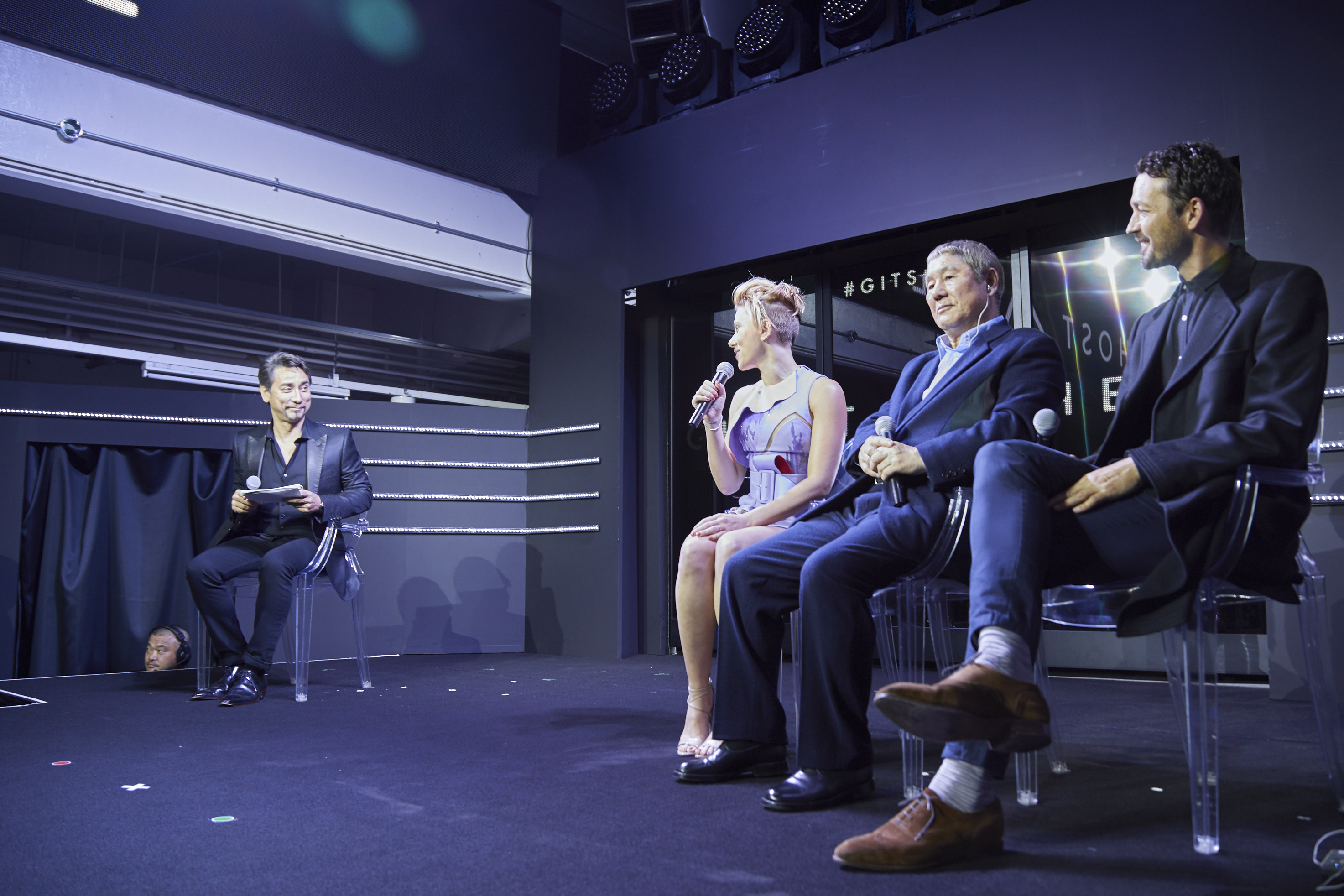 Scarlett Johansson, Takeshi Kitano, and Rupert Sanders getting interviewed during the Ghost in the Shell Fan Event at Tabloid in Tokyo, Japan November 13, 2016
